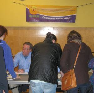 Photo of people signing up for solar site assessment