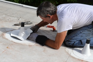 Photo of roofer working